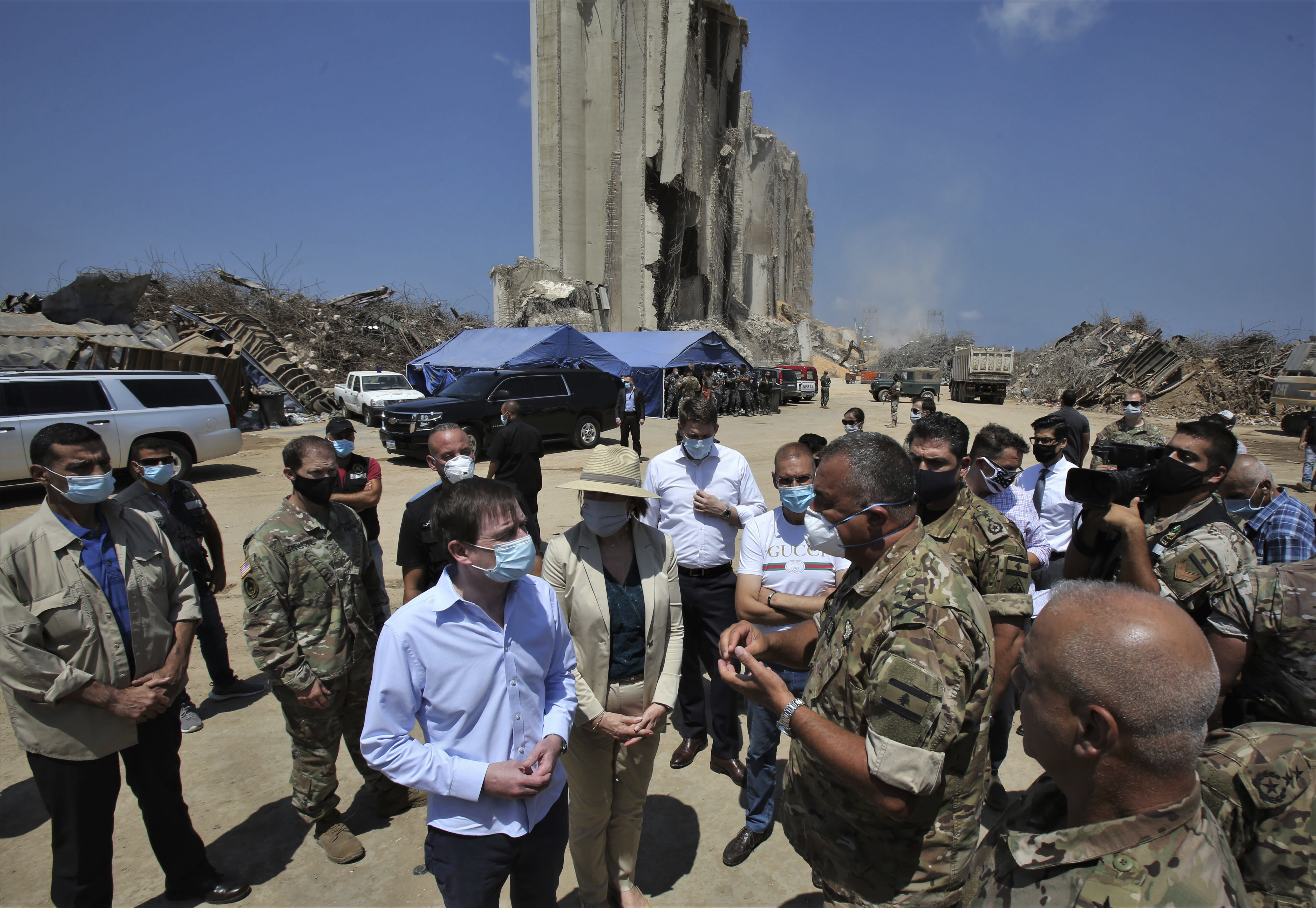 U.S. Undersecretary of State for Political Affairs David Hale, center left, and U.S. Ambassador to Lebanon Dorothy Shea, center right, visit the site of the Aug. 4 explosion in Beirut, Lebanon, Saturday, Aug. 15, 2020. (Nabil Monzer/Pool Photo via AP)