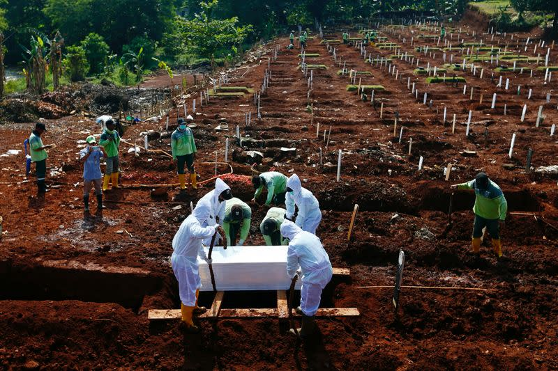Cemetery in Indonesia's capital running out of space as coronavirus cases surge