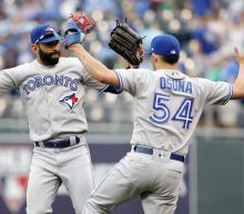 Osuna back on mound, finishes off Toronto's 8-2 win over KC