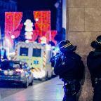 France hunts gunman who cried 'Allahu akbar' in Christmas market attack