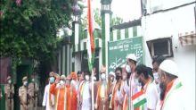 Leaders of different religions hoist national flag together