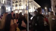 Londoners cram Oxford Circus for 'impromptu party' as crowds flood Soho streets at 10pm curfew