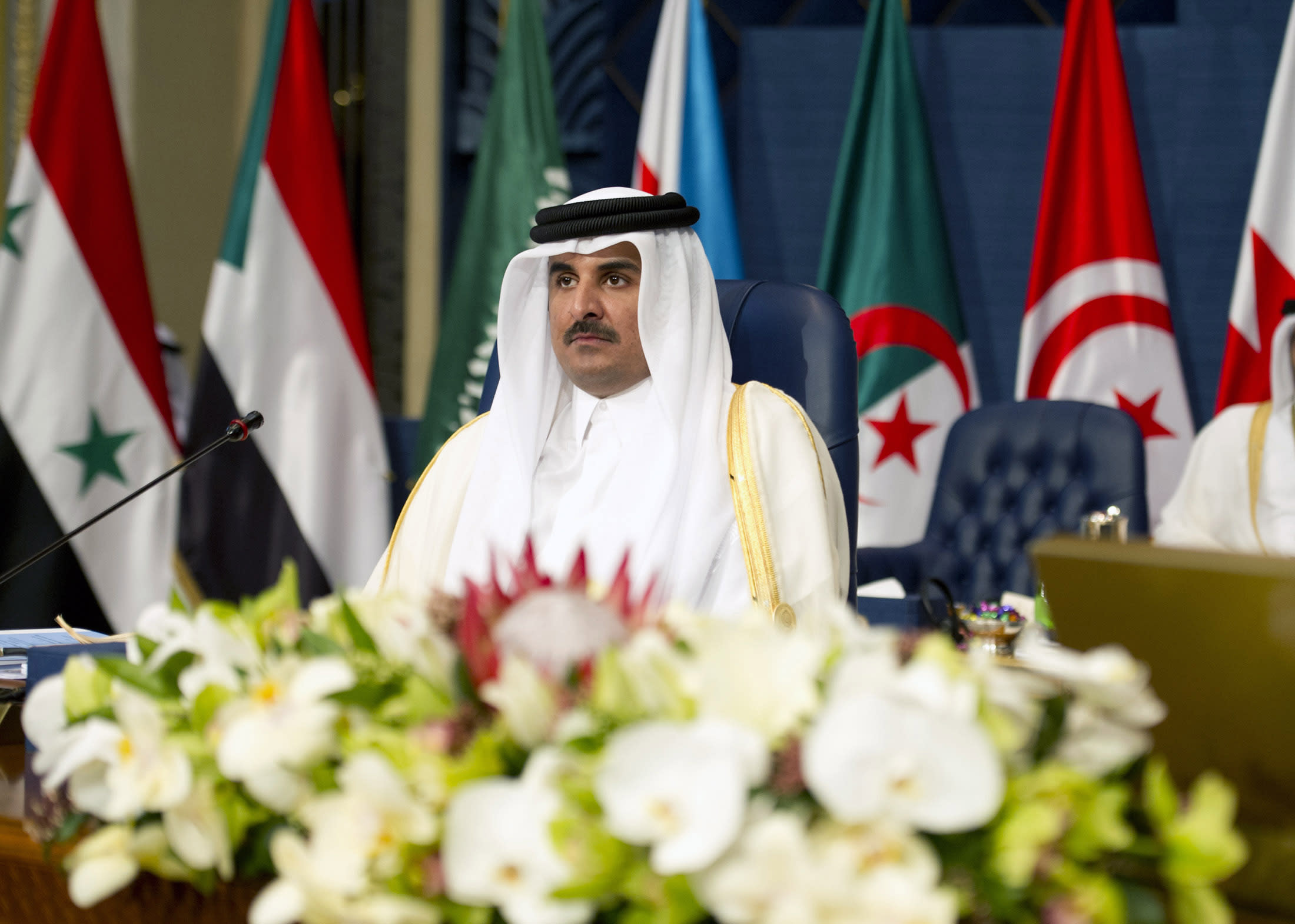 """In an interview with CNN on September 26, Qatar's Emir Sheikh Tamim insisted that laws for migrant workers have been changed, saying """"they are enforced and there are many laws that have been changed"""" (AFP Photo/Yasser al-Zayyat)"""
