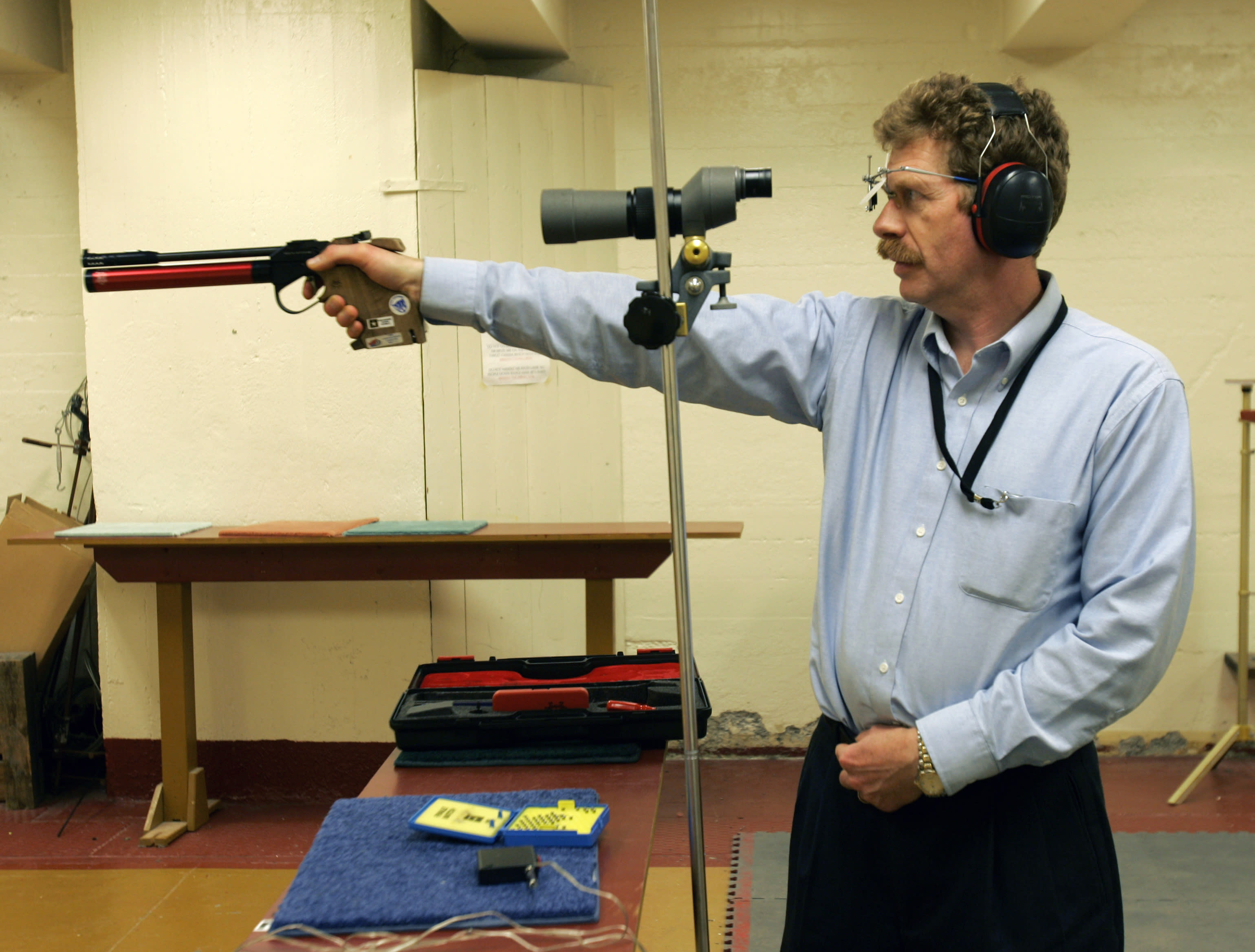 FILE--In this Feb. 21, 2007 file photo, Bruce Martindale takes aim as he competes in a weekly air gun league in Troy, N.Y. Martindale, who normally uses a .22-caliber, has cut back on practice because ammunition is in short supply. (AP Photo/Mike Groll, File)