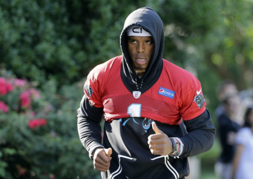 Cam Newton runs during the Panthers' minicamp in Charlotte, N.C. (AP)
