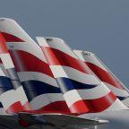 BA suspends more than 30,000 staff, owner scraps dividend