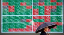 Global Markets: Asia stocks slip after Fed tempers aggressive rate cut expectations