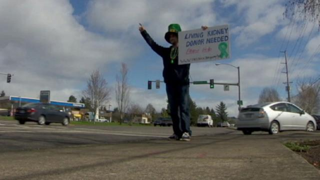 Man Holds Up Sign Asking for Kidney