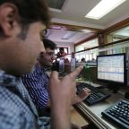Sensex, Nifty end higher; Reliance boosts