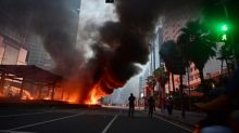 Protesters torch police posts as opposition mounts to new Indonesia law