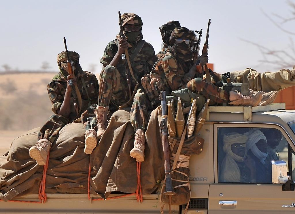 Soldiers of the Chadian army are driven in a pickup near Iriba, northern Chad on March 12, 2009
