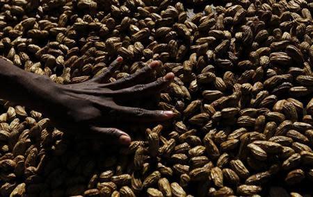A woman arranges peanuts at the main markets in Honiara September 14, 2012. REUTERS/Daniel Munoz
