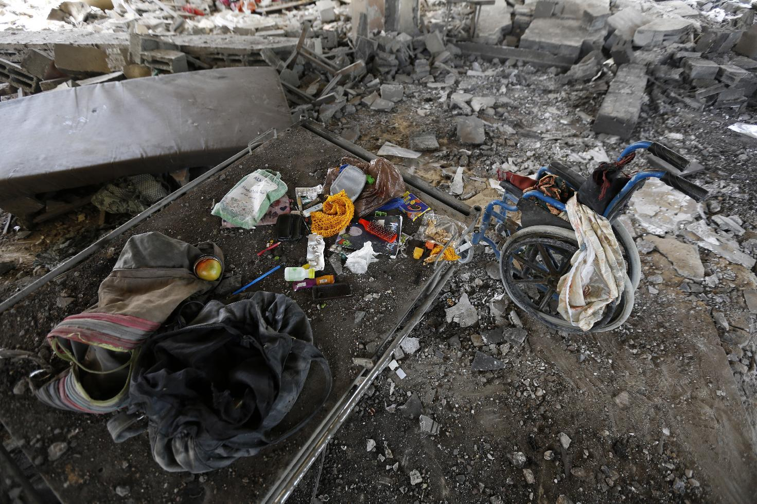 The contents of a Palestinian center for people with special needs are gathered after an Israeli air strike in Beit Lahia, northern Gaza Strip, on July 12, 2014 (AFP Photo/Mohammed Abed)
