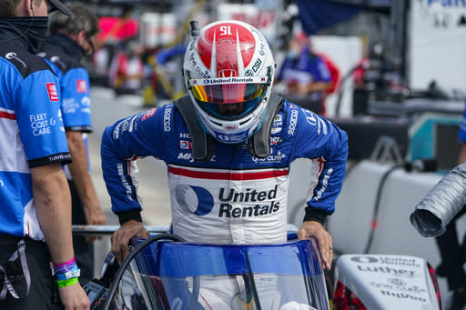 Graham Rahal climbs into his car during practice for the Indianapolis 500 auto race at Indianapolis Motor Speedway in Indianapolis, Friday, Aug. 14, 2020. (AP Photo/Michael Conroy)