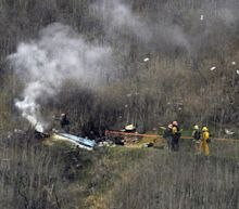 Investigators say the helicopter carrying Kobe Bryant missed clearing a hilltop by 20 to 30 feet