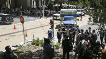 The Latest: Campus police defend delay in warning system