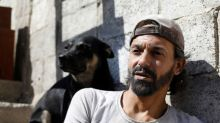 In Syria's Yarmouk, a pigeon keeper and his dog held out through years of war