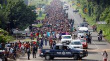 Thousands of Hondurans in U.S.-bound migrant caravan head into Mexico