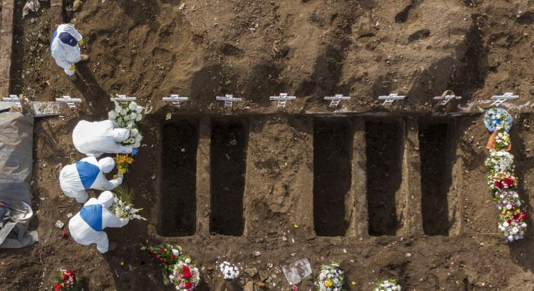 A COVID-19 victim is buried at the General Cemetery in Santiago, Chile