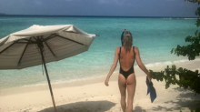 Guy Ritchie's wife Jacqui shows off her beach body on family vacation