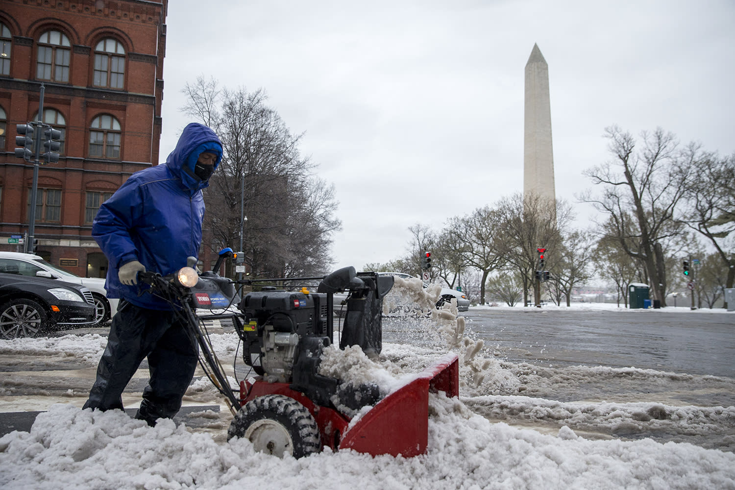 <p>A workman clears snow from a crosswalk near the National Mall in Washington, March 14, 2017. (Shawn Thew/EPA) </p>