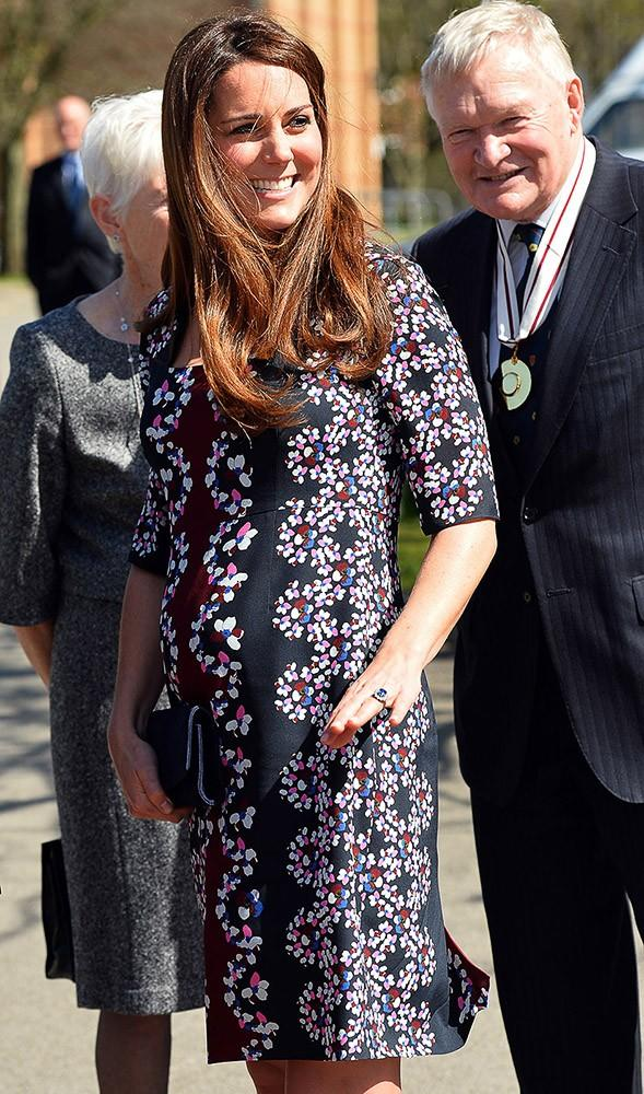 Kate visited a primary school in a pretty Erdem floral dress.