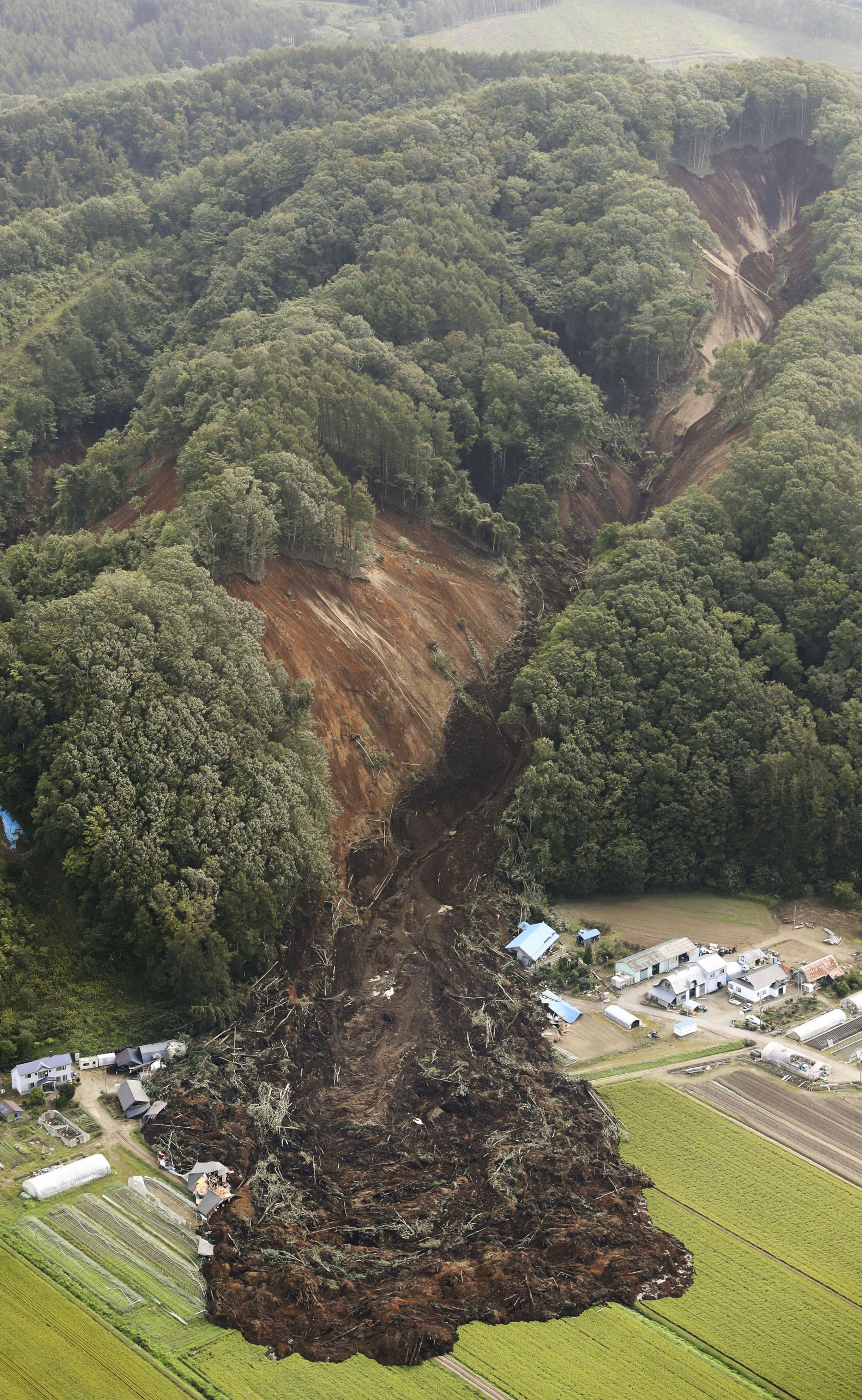 <p>This aerial photo shows the site of a landslide after an earthquake in Atsuma town, Hokkaido, northern Japan, Thursday, Sept. 6, 2018. (Photo: Kyodo News via AP) </p>
