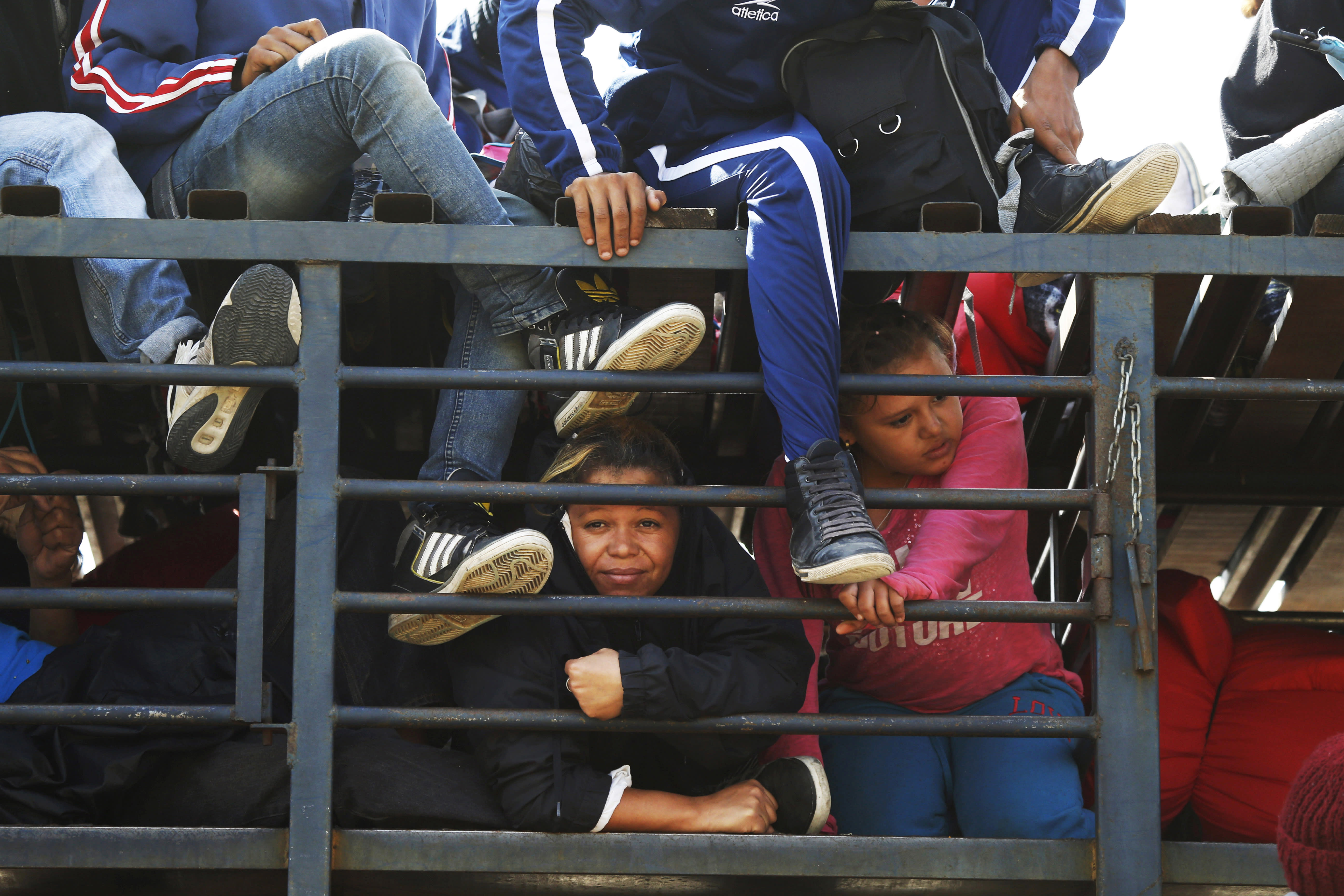 Central American migrants, part of the caravan hoping to reach the U.S. border, get a ride on a truck, in Celaya, Mexico, Sunday, Nov. 11, 2018. Local Mexican officials were once again Sunday helping thousands of Central American migrants find rides on the next leg of their journey toward the U.S. border. (AP Photo/Marco Ugarte)