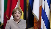 Markets like euro crisis deal, Merkel defensive