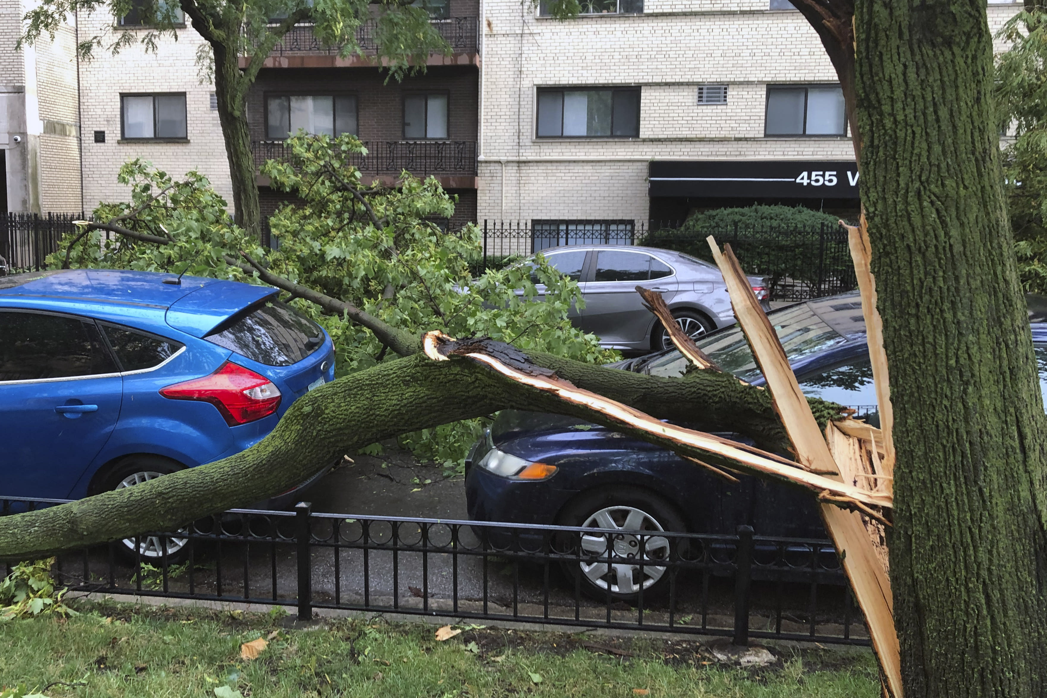 A downed tree limb blocks a roadway in Chicago's Lakeview neighborhood on Monday, Aug. 10, 2020. A rare storm packing 100 mph winds and with power similar to an inland hurricane swept across the Midwest on Monday, blowing over trees, flipping vehicles, causing widespread property damage, and leaving hundreds of thousands without power as it moved through Chicago and into Indiana and Michigan. (AP Photo/Tom Berman)