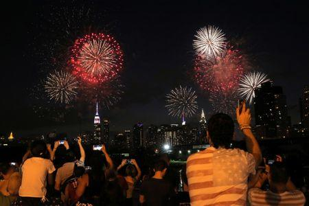 People watch the Macy's 4th of July Firework Show from Brooklyn in New York City