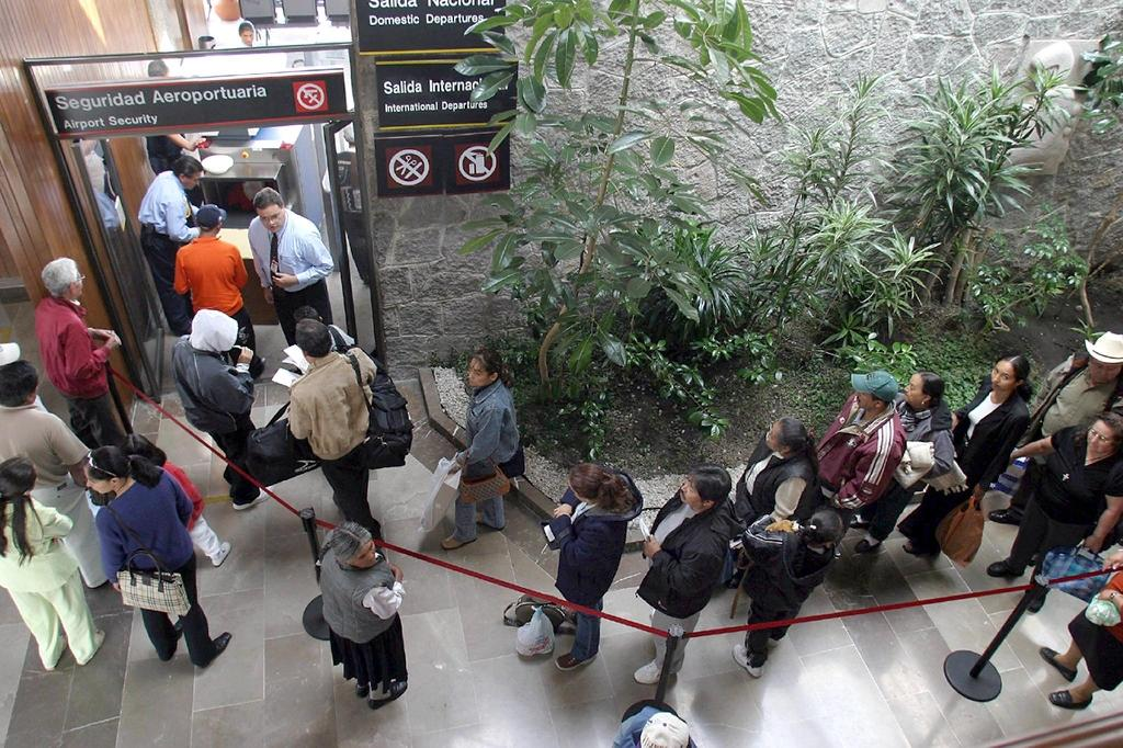 Passengers go through security at Toluca airport in Mexico, where authorities have seized $450 million worth of debt securities