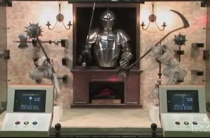 Robot arms do battle... Medieval Times-style