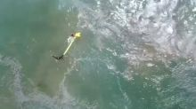 Incredible video shows drone helping to rescue swimmers in trouble
