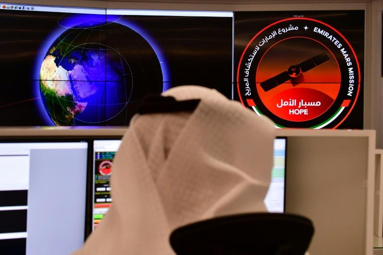 An employee in the control room of the Mars Mission at the Mohammed Bin Rashid Space Centre in the Gulf city of Dubai (AFP Photo/GIUSEPPE CACACE)