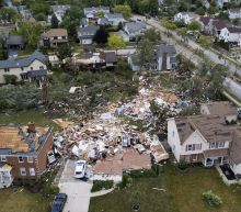 Drone video shows aftermath of tornado in Chicago-area suburbs