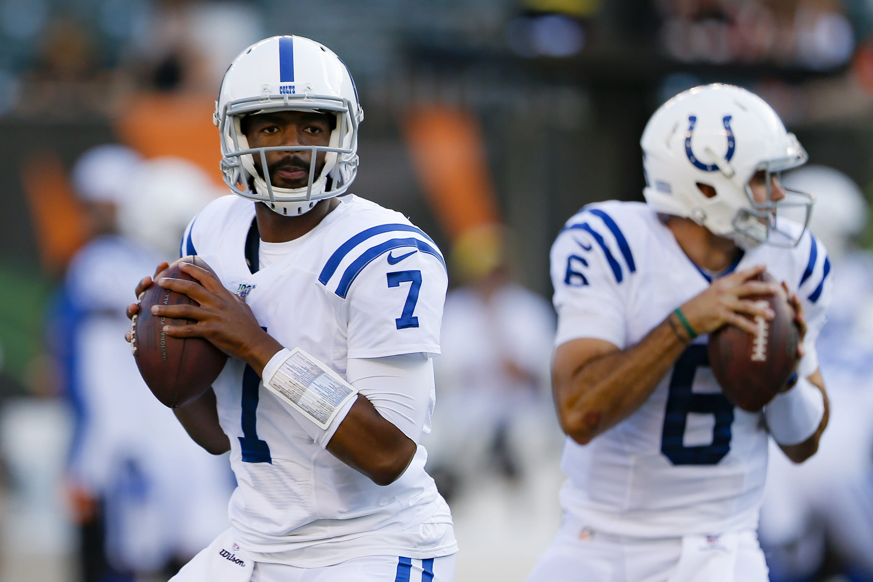 Indianapolis Colts quarterbacks Jacoby Brissett (7) and Chad Kelly warm up for the team's FL preseason football game against the Cincinnati Bengals, Thursday, Aug. 29, 2019, in Cincinnati. (AP Photo/Gary Landers)