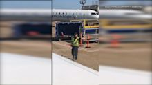VIDEO: Passenger says American Airlines employee dancing on tarmac is 'living his best life'