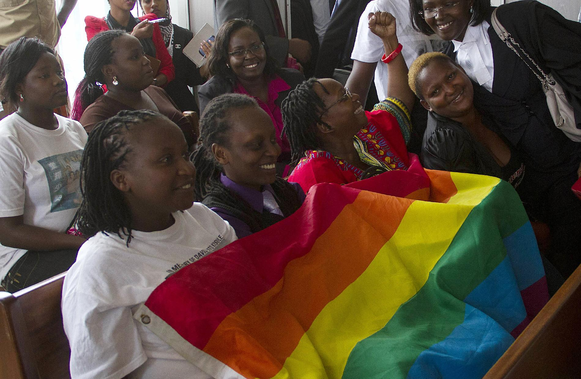 Members of Uganda's gay community and gay rights activists react as the constitutional court overturns anti-gay laws in Kampala on August 1, 2014 (AFP Photo/Isaac Kasamani)