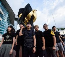 Hong Kong activists stage China protest ahead of Xi visit
