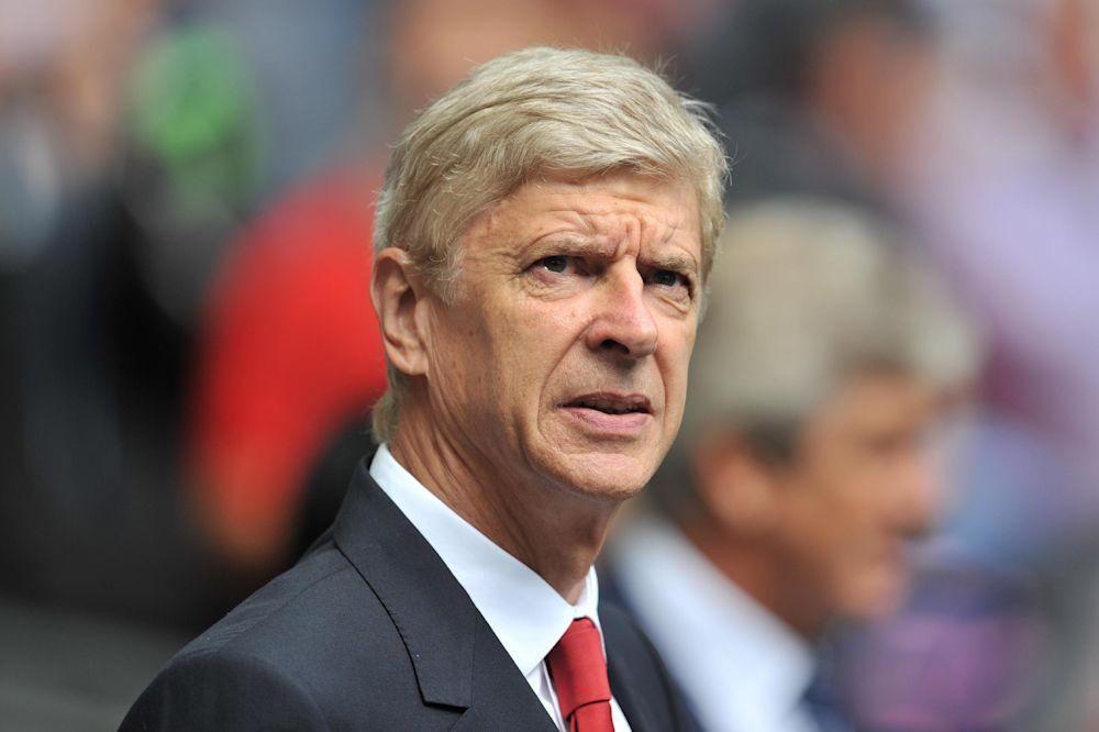 Arsenal's French manager Arsene Wenger waits for kick off of the FA Community Shield football match between Arsenal Manchester City at Wembley Stadium in north London on August 10, 2014