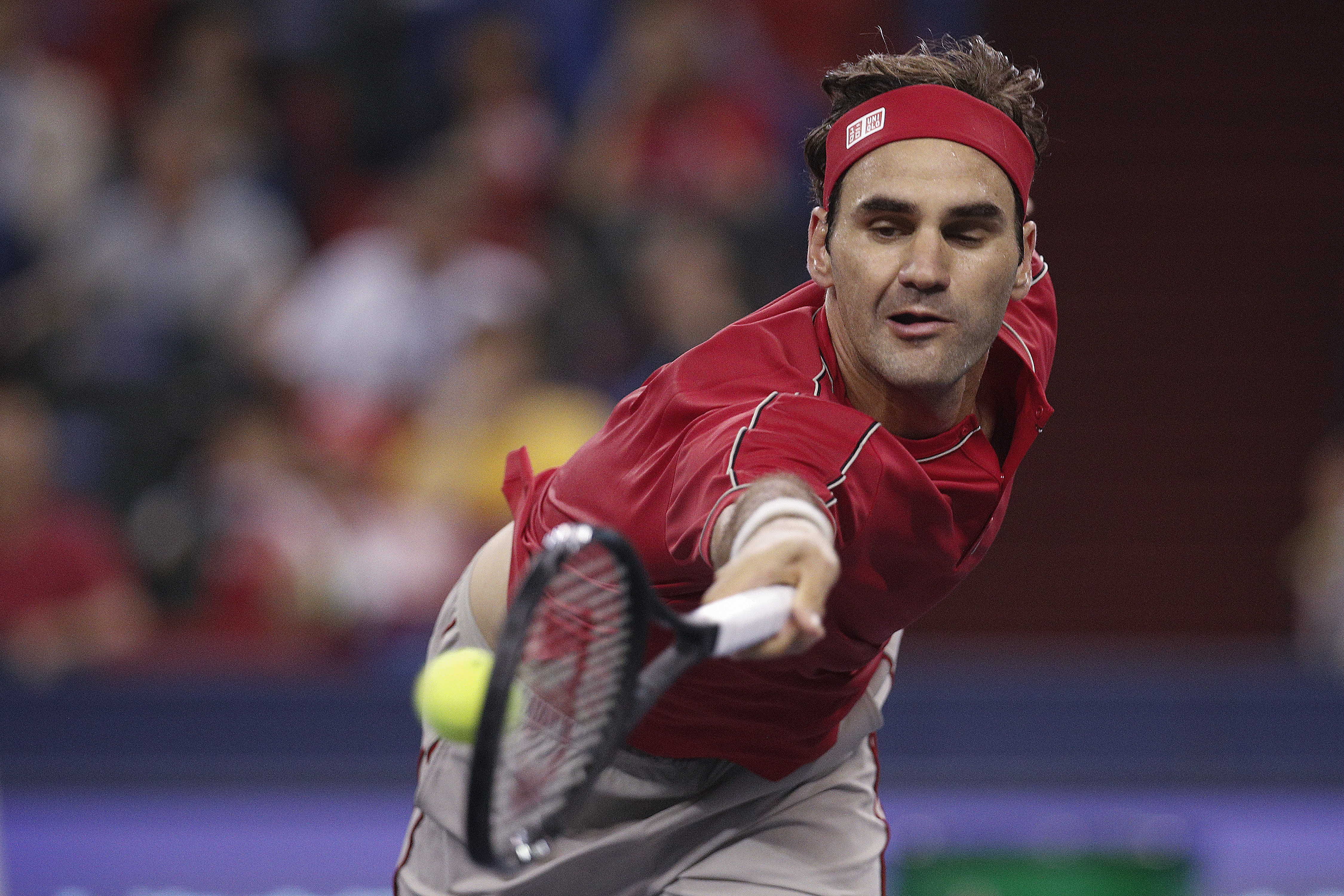 Roger Federer of Switzerland hits a return shot against Albert Ramos-Vinolas of Spain during their men's singles match at the Shanghai Masters tennis tournament at Qizhong Forest Sports City Tennis Center in Shanghai, China, Tuesday, Oct. 8, 2019. (AP Photo/Andy Wong)