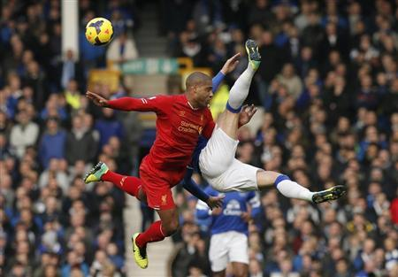 Liverpool's Johnson challenges Everton's Barkley during their English Premier League soccer match at Goodison Park in Liverpool