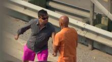 Road-raging motorists fail to spot cop standing metres away