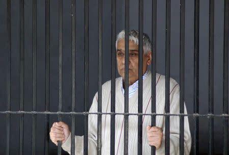 "Satguru Rampalji Maharaj, a self-styled ""godman"" is seen inside a police lock-up after his arrest, at Panchkula in the northern Indian state of Haryana November 20, 2014. REUTERS/Stringer"
