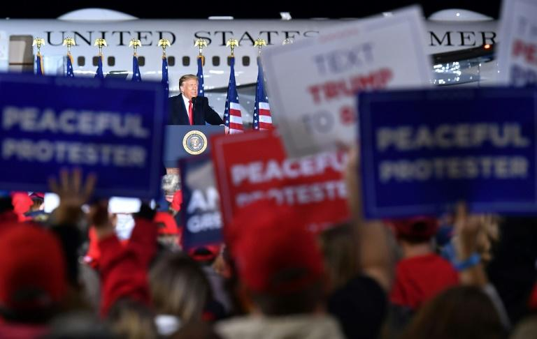 As his 2020 Democratic challenger Joe Biden held a socially distant town hall in Pennsylvania, US President Donald Trump hosted a boisterous public rally at a Wisconsin airport