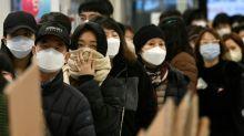 Asian markets mixed after virus-fuelled global bloodbath