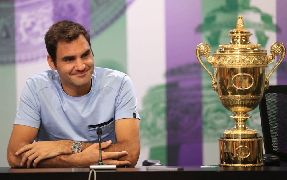 Federer poses with the Wimbledon trophy after what sounds like heavy night - PA