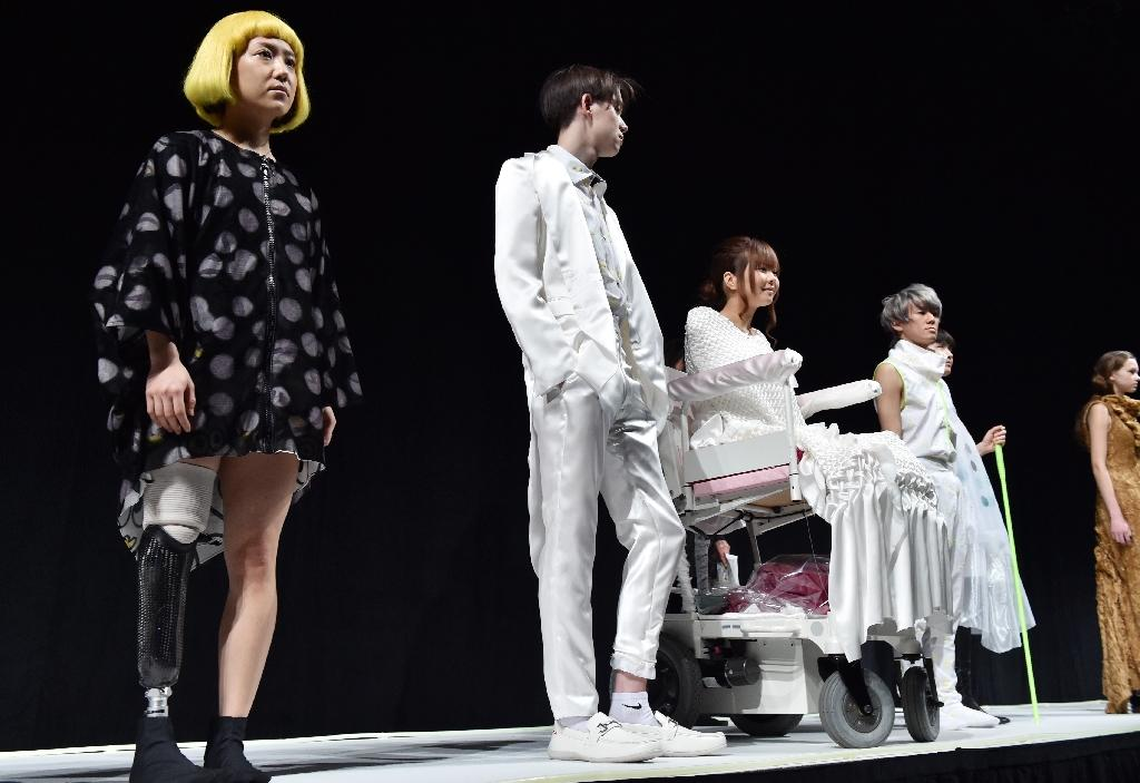 "Models take part in rehearsals for the ""tenbo"" fashion show, designed by Japanese designer Takafumi Tsuruta, during Tokyo Fashion Week on March 18, 2015 (AFP Photo/Yoshikazu Tsuno)"