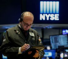 Wall Street rises with retailers, commodities boost